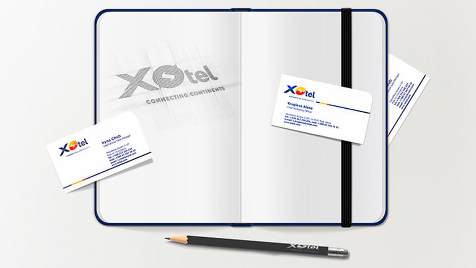 Логотип на визитках Xotel © Креативное агентство KENGURU