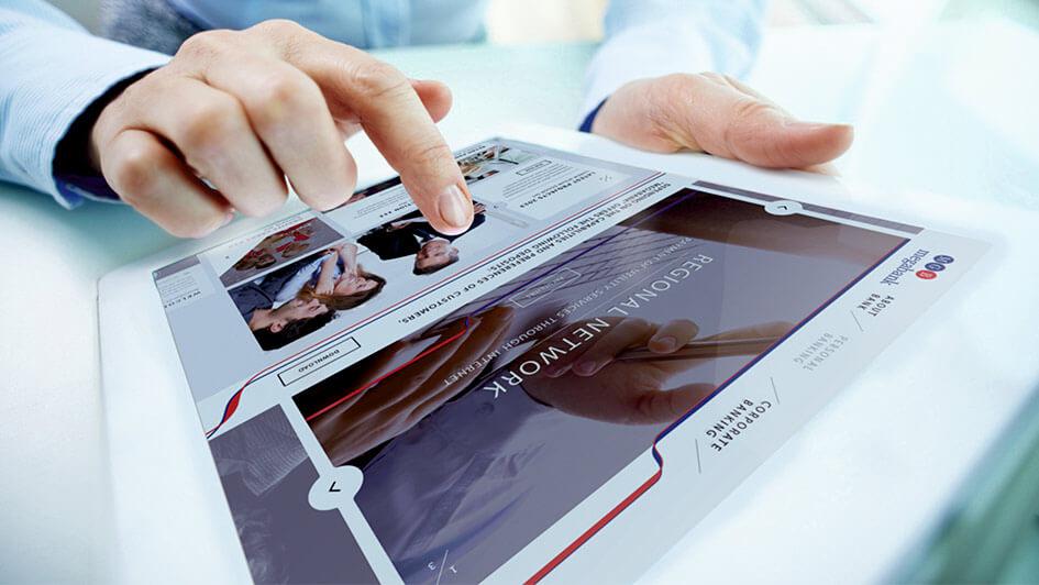 Использование фирменной графики на сайте компании МЕГАБАНК © Креативное агентство KENGURU